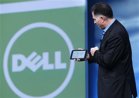 File photograph of Dell founder and CEO Michael Dell displaying a Dell tablet computer in San Francisco